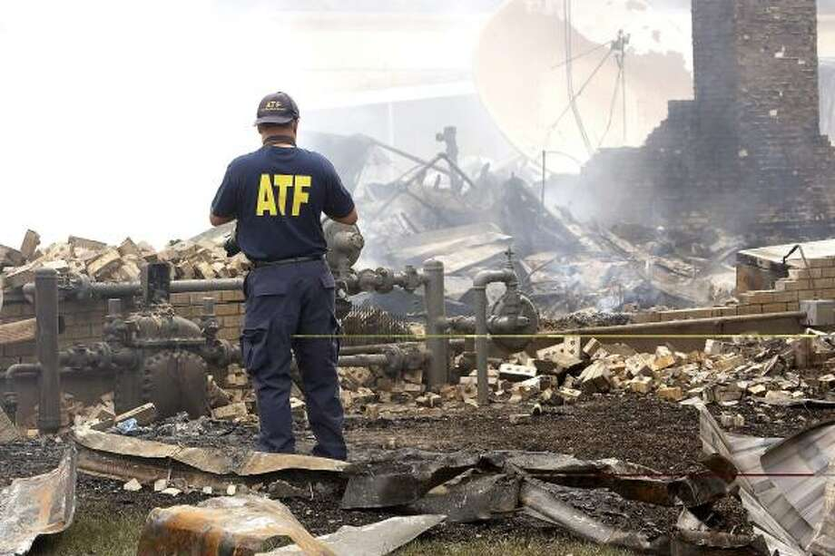 Alcohol Tobacco & Firearms agent Buddy Wood looks over the scene of a  fire that destroyed part of Needville High School on April 23. Photo: Bob Levey, AP