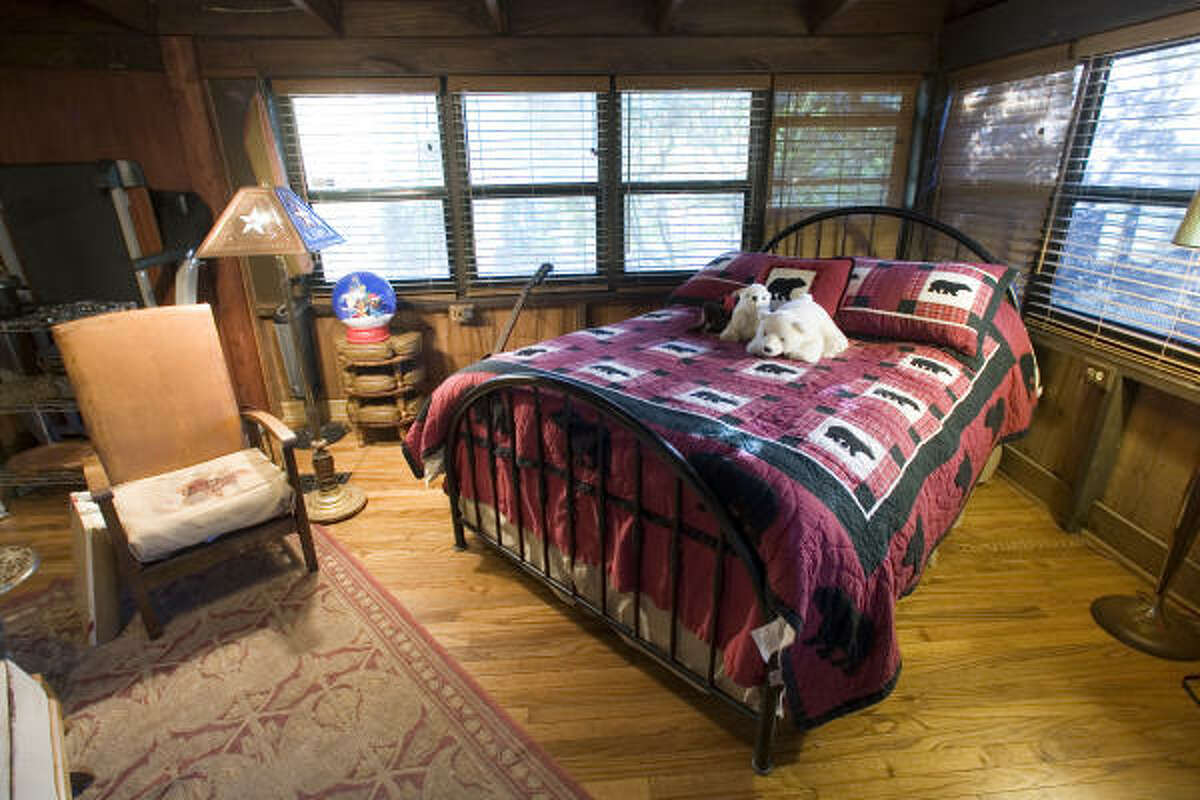 A quilt makes a bedroom in the cabin warm and cozy.