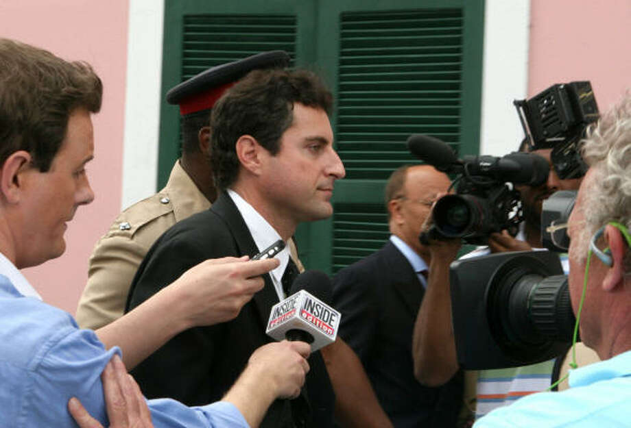 Howard K. Stern walks through a group of reporters as he enters the Bahamian Supreme Court March 20, in Nassau, Bahamas. Photo: TIM AYLEN, Associated Press