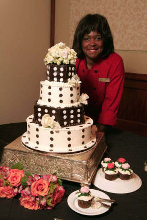 Lisa Green of Kiss the Cook Cakes shows off one of her Polka Dot Cakes. The cake takes six to eight hours to bake and decorate. Photo: Eric Kayne, Chronicle