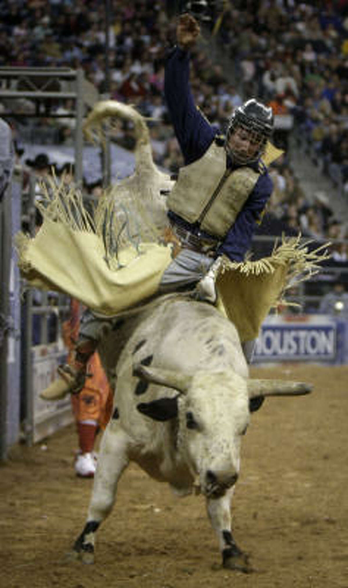 Stormy Wing of Dalhart rides Mr. Bojangles during Saturday's bull riding competition at RodeoHouston.