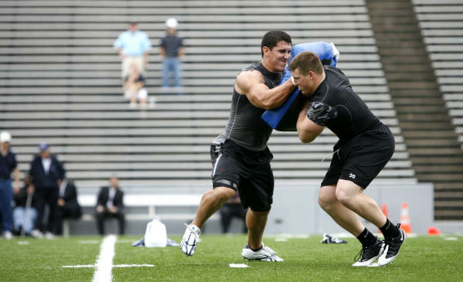 Ex-Rice tight end James Casey, left, runs a blocking drill for scouts against Army's Collin Mooney last month. Photo: Karen Warren, Chronicle