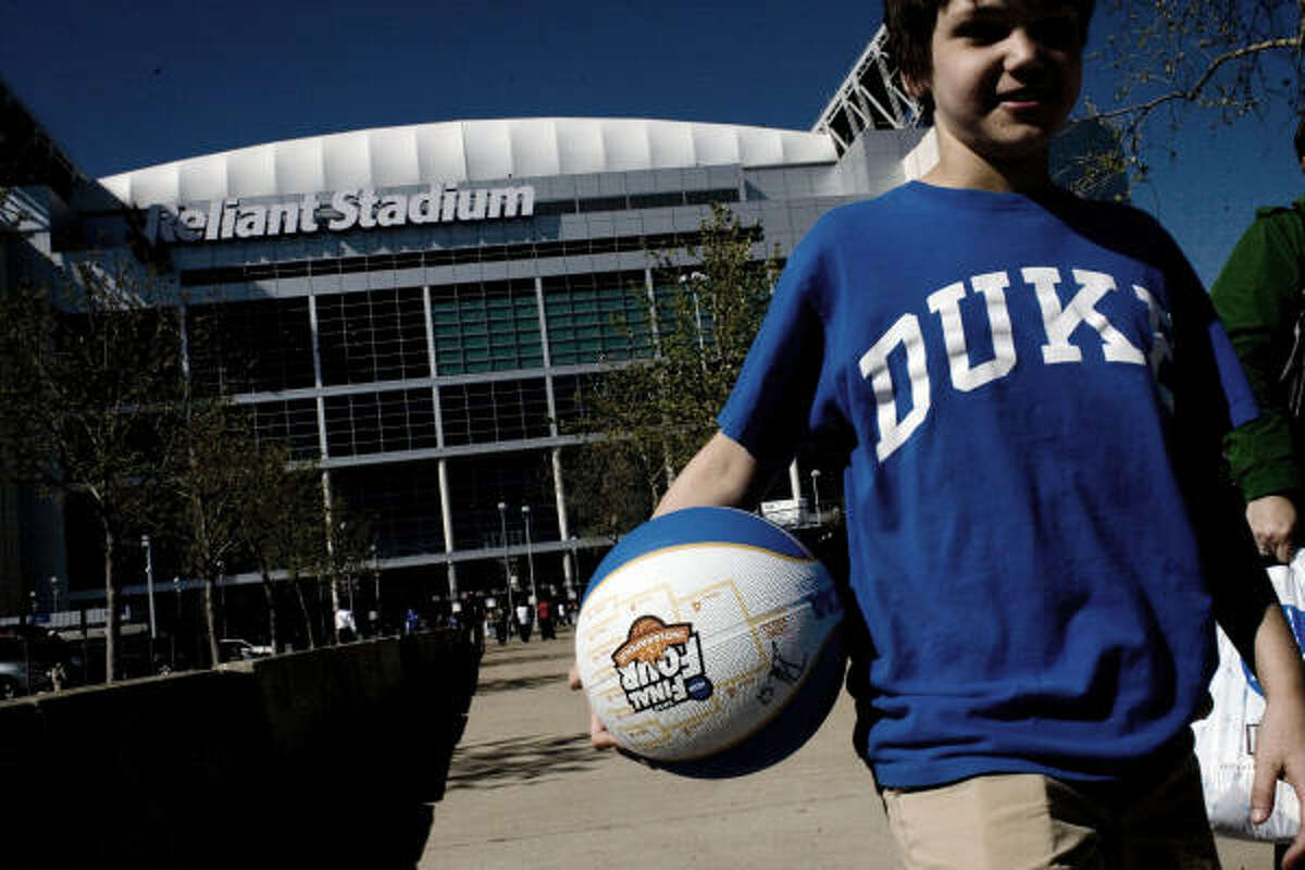 Garrett Herzik, 12, of Spring, walks out of Reliant Stadium last week after watching Duke and others practice. He'll have more opportunities in coming years to see NCAA ball at his home court.