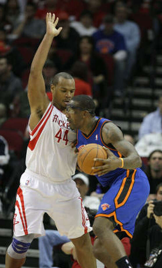 As part of a nightmarish stretch for a defensive player, the Rockets' Chuck Hayes took on Amare Stoudemire on Wednesday night. Stoudemire scored 25 points, but the Rockets were able to keep the other Knicks in check because Hayes didn't need double-team help on Stoudemire. Photo: Karen Warren, Chronicle
