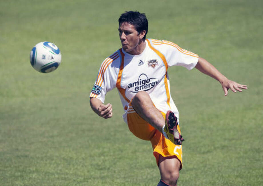 Dynamo forward Brian Ching will be out at least a few days with a strained right hamstring. Photo: Bob Levey, AP