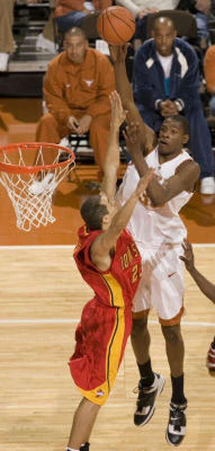 Kevin Durant shoots for two of his 17 points over Iowa State's Chris Ceaser. Durant shot just 6-of-16 from the field, scoring less than 26 points for the first time in Big 12 competition this season. Photo: Jim Sigmon, AP