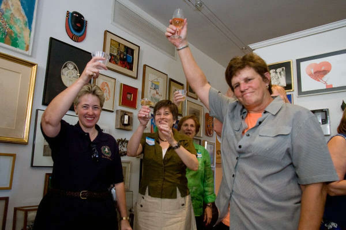 Houston City Controller Annise Parker, left, Jane Cahill of the Old Sixth Ward Neighborhood Association; Virginia Roeder and Houston City Council member Sue Lovell toast the success of the preservation effort at a reception celebrating the designation of the Old Sixth Ward Historic District.