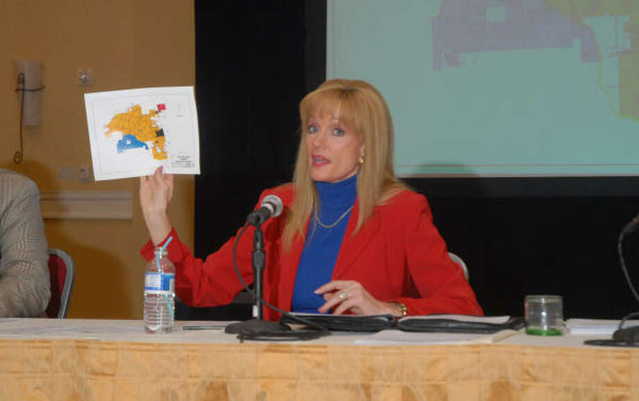 Nelda Blair, chairwoman of the Town Center Improvement District, holds a map of The Woodlands during the TCID public forum on the future of The Woodlands and freedom from annexation by Houston and Conroe. More than 200 people attended the assembly at The Woodlands Waterway Marriott. Photo: David Hopper, For The Chronicle