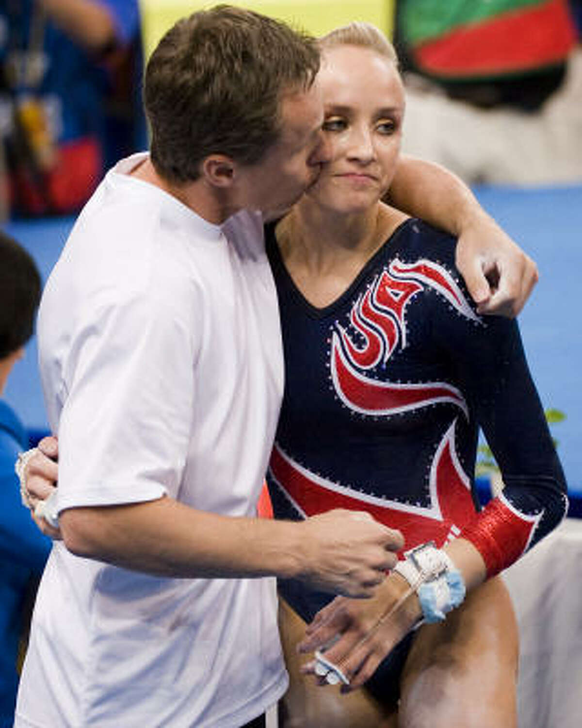 Father, coach and former Olympian himself Valeri Liukin consoles daughter Nastia after the final.