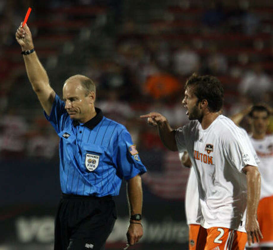 The Dynamo's Eddie Robinson has good reason to be wary of the officials. Photo: REX C. CURRY, AP