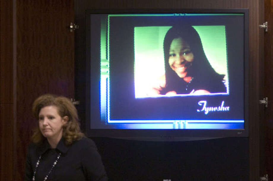An image of Tynesha Stewart is shown on a screen at the trial of Timothy Shepherd on Wednesday. Photo: Brett Coomer, Chronicle