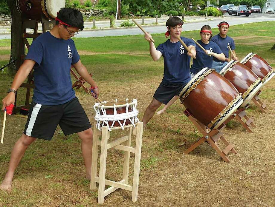 Taiko Drum Group from the University of Connecticut performs at the Bon-Odori Festival on Saturday at Jesup Green. Formed in 2004, the group practices Kumi-Daiko, an ensemble style that fuses traditional Japanese Taiko drumming with modern influences. Photo: Mike Lauterborn / Westport News freelance