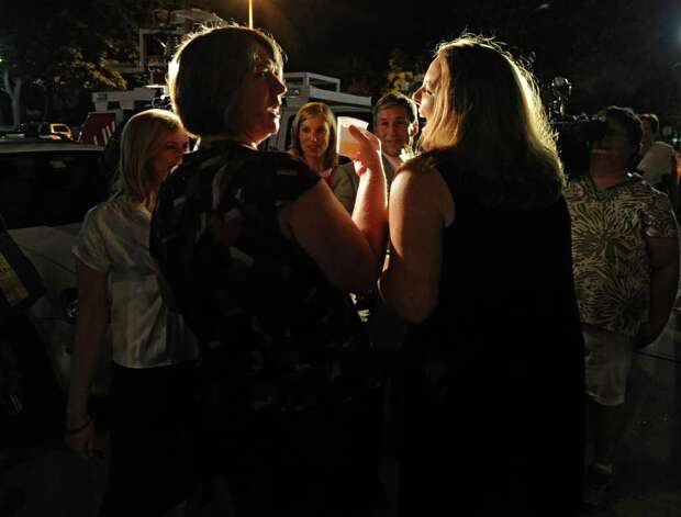 Joanne Trinkle, left, and Beth Relyea make a toast after exiting City Hall in Albany, N.Y. and being one of the first same-sex couples to marry in New York State on Sunday, July 24, 2011.  (Lori Van Buren / Times Union) Photo: Lori Van Buren
