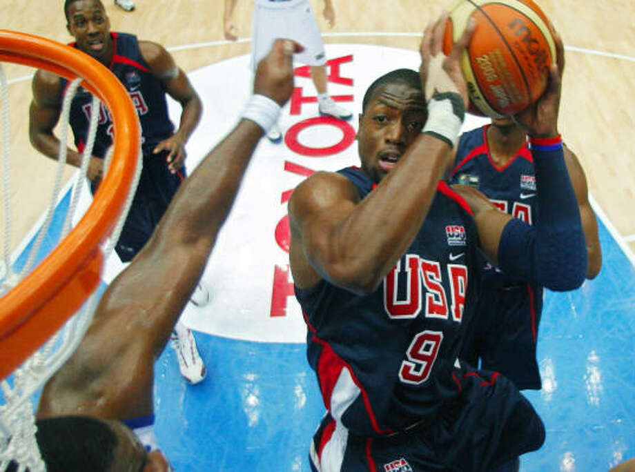 Team USA's Dwyane Wade, (9),  puts up a shot as Greece's Sofoklis Schortsanitis, left,  guards. Photo: MARK J. TERRILL, AP