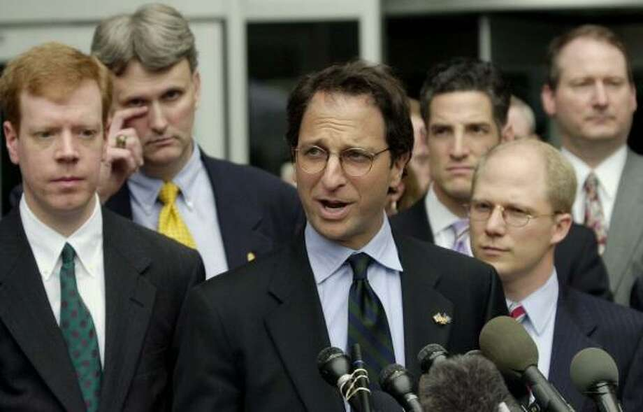 Former Enron Task Force Director Andrew Weissman, center, was surprised at Fastow's sentence. Photo: DAVID J. PHILLIP, AP