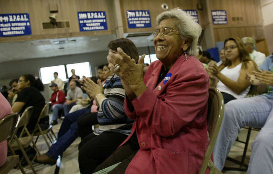 Justina Gonzales, 81, a Near Northside resident for 60 years, and others cheer Sunday at Mayor White's announcement of a city commitment to prevent displacement of the neighborhood's residents. Photo: Jessica Kourkounis, For The Chronicle