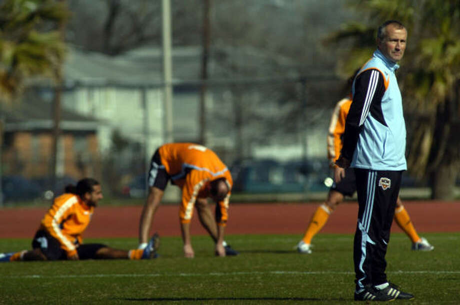 Dynamo coach Dominic Kinnear, right, will try to get as many players field time as possible in the team's final two tuneups before departing for Costa Rica to play Puntarenas FC. Photo: Johnny Hanson, For The Chronicle