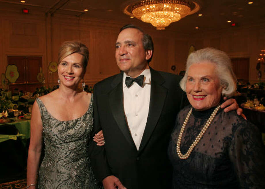 Honored at the JCC Scholarship Ball were Renee Suchowiecky, from left, David Mendez and Nan Schissler, representing her entire family. Photo: Gary Fountain, For The Chronicle