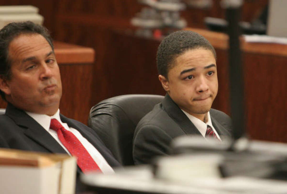 Attorney Anthony Osso, left, with Dexter Johnson. The state is seeking the death penalty.