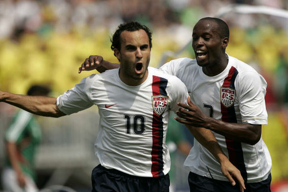 United States Landon Donovan (10) celebrates with DaMarcus Beasley after scoring on a penalty kick against Mexico in the second half of the CONCACAF Gold Cup final. The score tied the match, which the Americans went on to win 2-1. Photo: José M. Osorio, MCT
