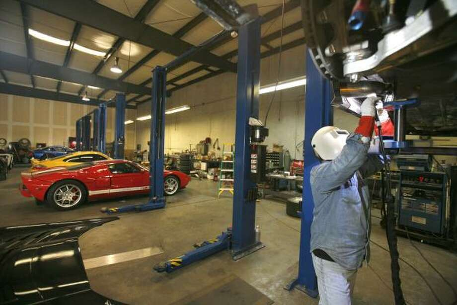 Alan Webb, head fabricator at Hennessey Performance Engineering in northwest Houston, welds exhaust tips on a Viper Competition Coupe. John Hennessey, owner of the shop, has built his hobby into a $4 million-a-year business. Photo: STEVE CAMPBELL, CHRONICLE