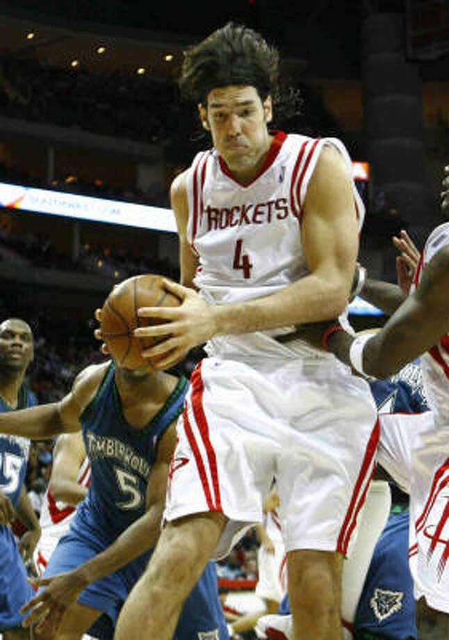Rockets forward Luis Scola grabs an offensive rebound against the Timberwolves in the fourth quarter. Photo: Nick De La Torre, Chronicle