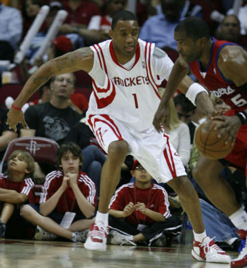 The Rockets Tracy McGrady (left) guards ex-Rocket Cuttino Mobley on Wednesday. Photo: James Nielsen, Chronicle