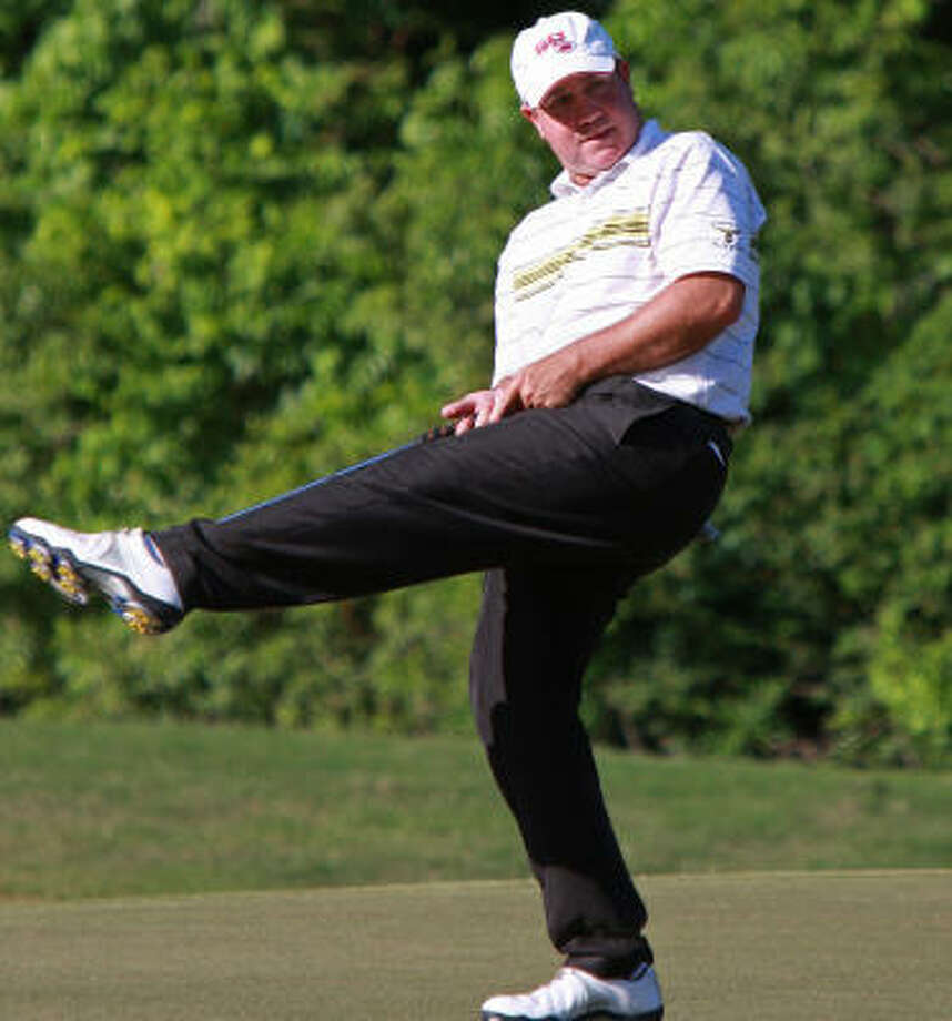 Robby McWilliams reacts to a missed putt at No. 17 at Champions Golf Club. Photo: Gary Fountain, For The Chronicle