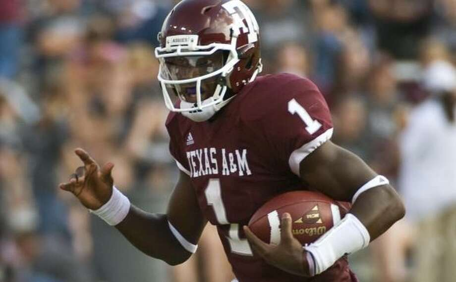 A&M quarterback Jerrod Johnson completed 19 of 32 passes for 275 yards and three touchdowns in Saturday's loss. Photo: Dave Einsel, AP