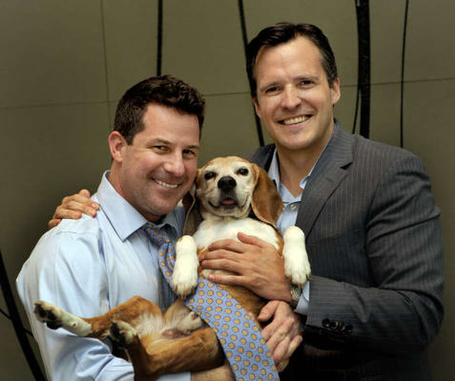 Jeremy Bernard, left, shown with partner Rufus Gifford and their dog Lucas, is the third person to hold the social secretary post in the Obama administration. Photo: Linda Davidson, Washington Post