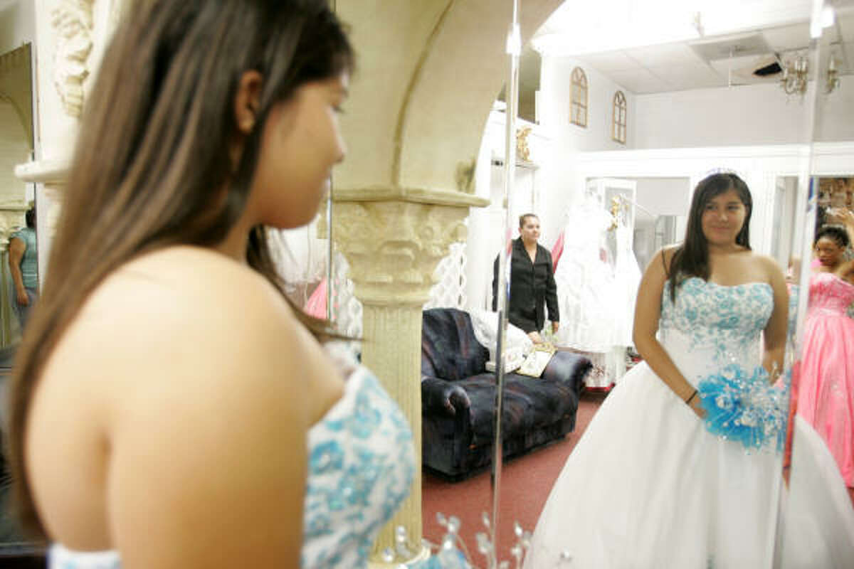 Priscilla Villarreal checks out her quinceañera gown in her final fitting at John's Formal Wear & Bridal Boutique.