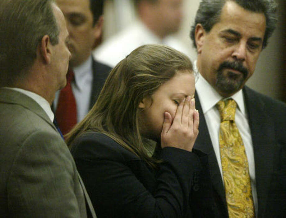 Ashley Benton cries as a mistrial is declared on Friday. Her attorneys, Brian Wice, left, and Kent Schaffer, argued the stabbing of rival gang leader Gabriel Granillo was in self-defense. Photo: Billy Smith II, Chronicle