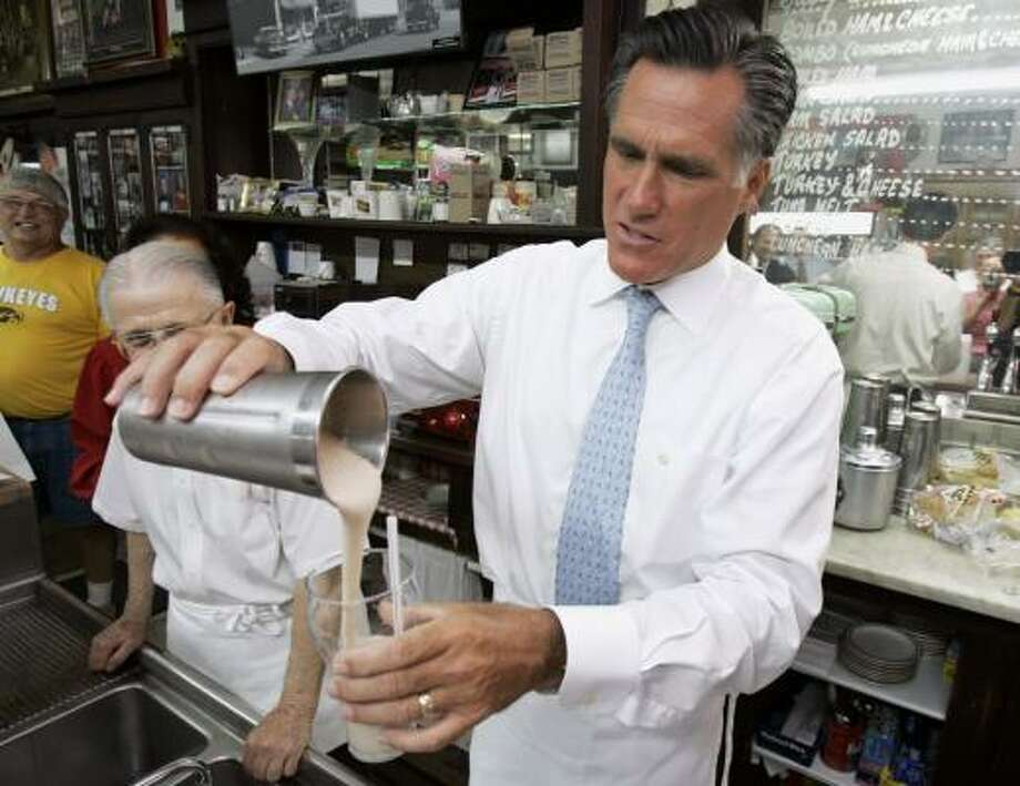 Mitt Romney pours a milkshake during a campaign stop Wednesday at the Wilton Candy Kitchen in Wilton, Iowa. Photo: CHARLIE NEIBERGALL, ASSOCIATED PRESS