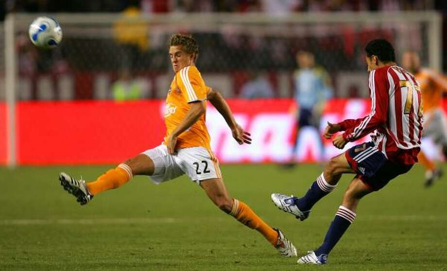 Midfielder Stuart Holden attempts to block a pass by Chivas USA's Orlando Perez during the Dynamo's scoreless draw Saturday night in Carson, Calif. Photo: VICTOR DECOLONGON, GETTY IMAGES