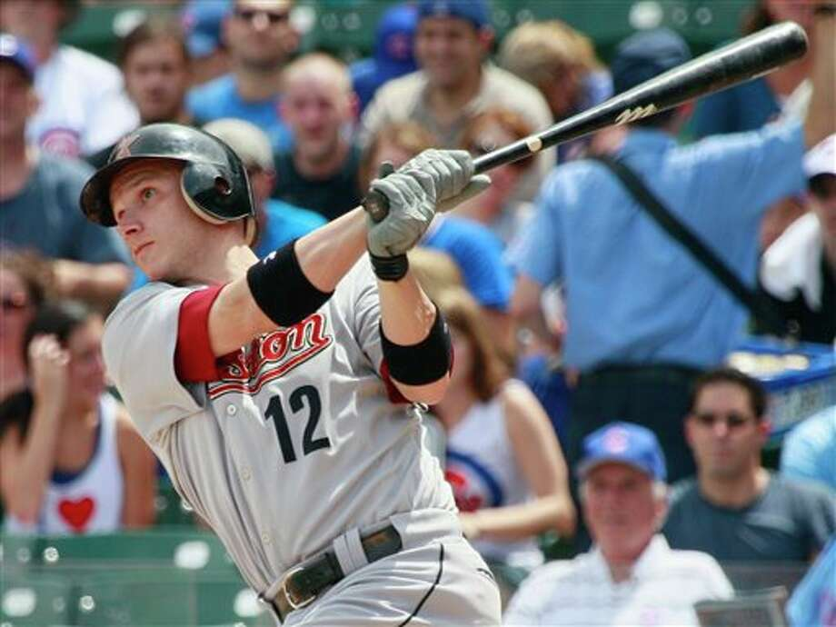 Houston Astros' Clint Barmes watches his solo home run against the Chicago Cubs during the first inning of a baseball game Sunday, July 24, 2011, in Chicago. (AP Photo/Nam Y. Huh) Photo: Associated Press