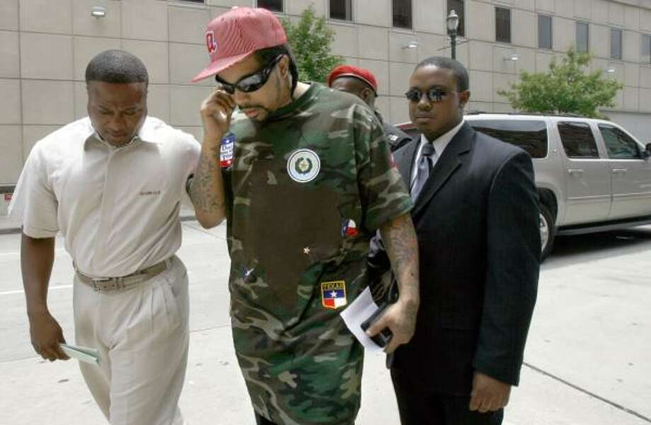 Houston-based rapper Lil' Flip, whose real name is Wesley Eric Weston Jr., is escorted to the Harris County Courthouse by Quanell X, left. The artist, who faces a felony charge, posted bond. Photo: JOHNNY HANSON, FOR THE CHRONICLE