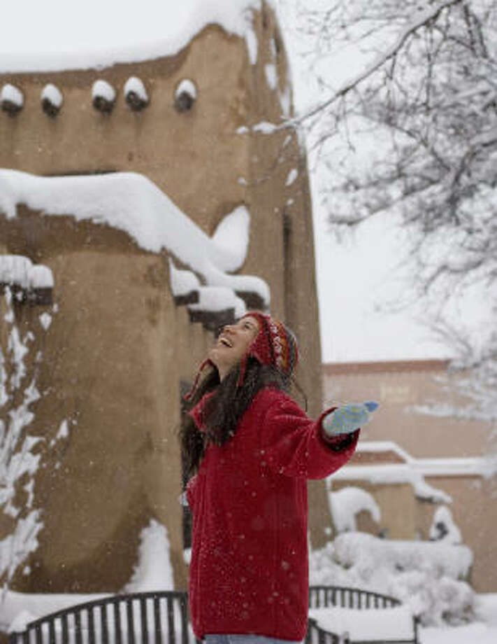 Snow blankets Santa Fe's Museum of Fine Arts Building on the Plaza. Photo: Douglas Merriam, Handout