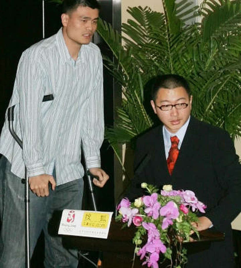 Yao Ming arrives in China earlier this month. He since has been cleared to stop using his crutches. Photo: Greg Baker, AP