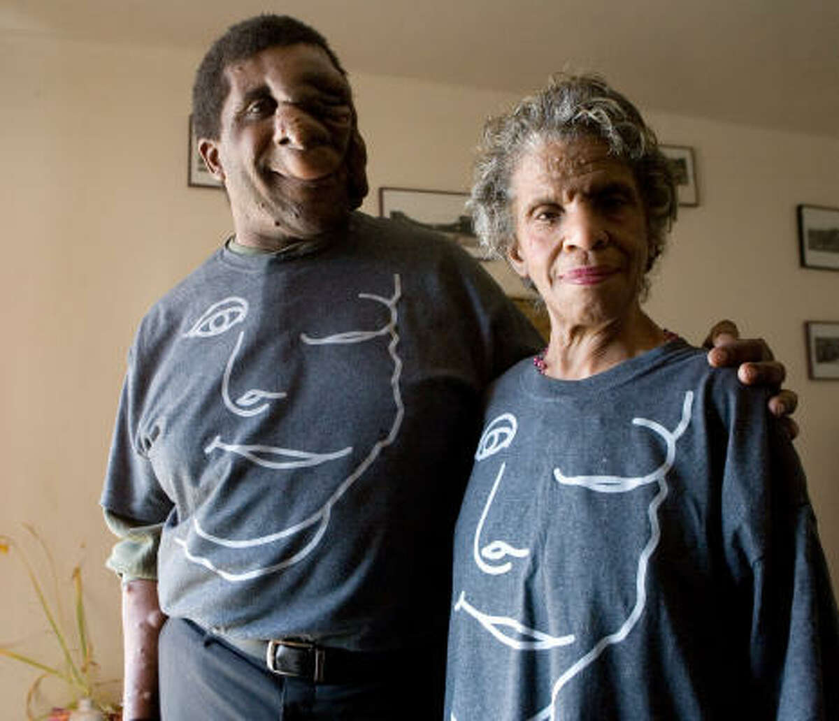 """Reggie Bibbs and his mother, Dorothy Bibbs, wear their their """"Just Ask!"""" shirts. Reggie Bibbs received a reward for his """"Just Ask!"""" campaign."""