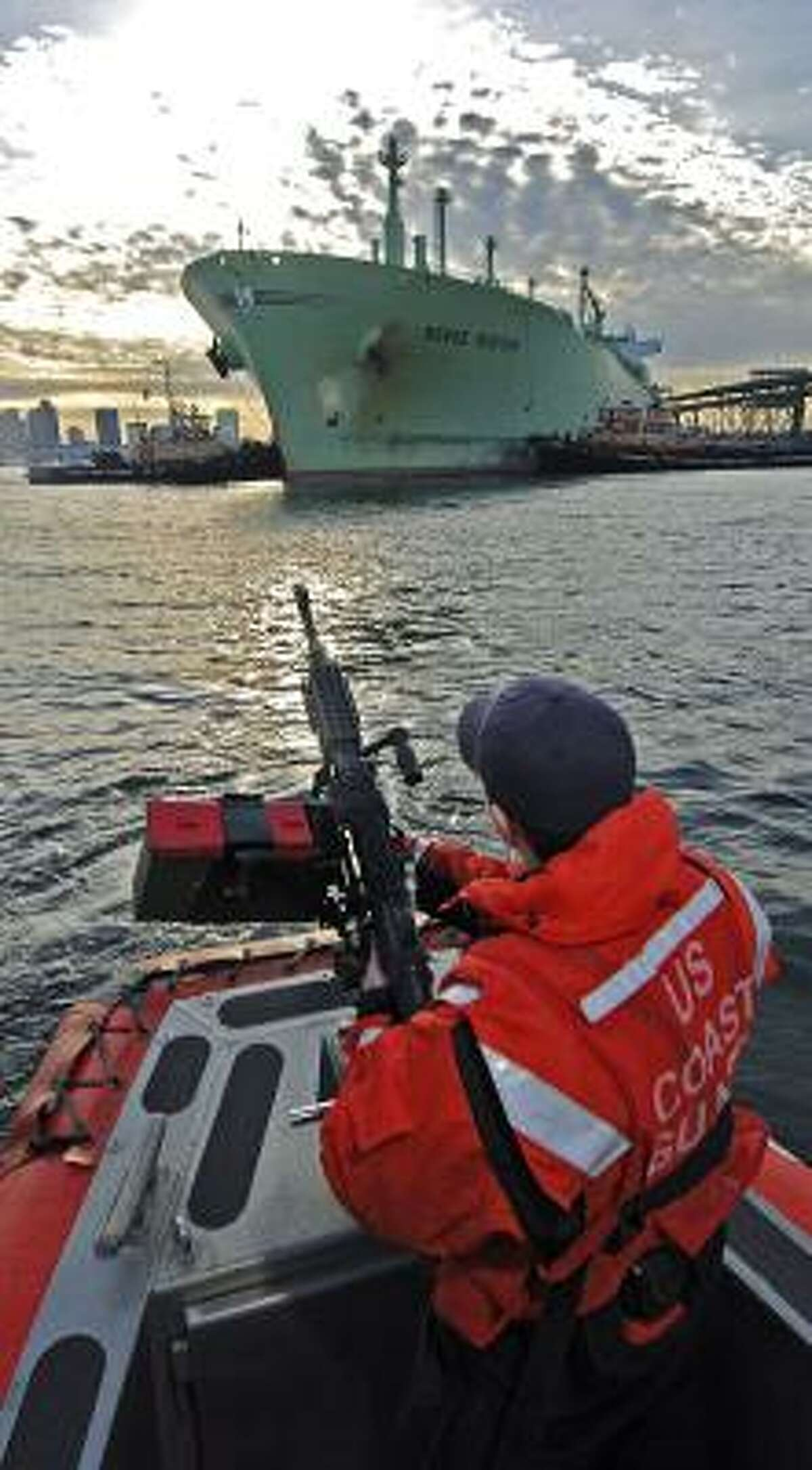 Coast Guard Seaman Darcy McGrail mans an M-240-B machine gun during a security escort of the liquid natural gas tanker Berge Boston in Boston Harbor in January. A congressional study questions how prepared the government is to handle a terrorist attack on an LNG facility.