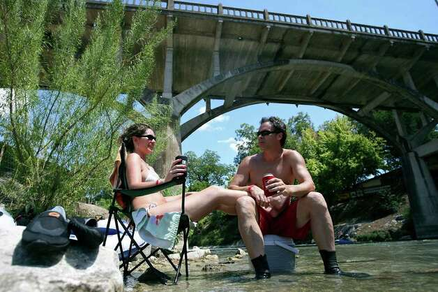 April Spence (left) and Jay Byars relax in the Comal River Sunday July 24, 2011 at Prince Solms Park in New Braunfels. Photo: EDWARD A. ORNELAS, Edward A. Ornelas/Express-News / © SAN ANTONIO EXPRESS-NEWS (NFS)