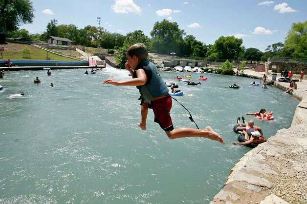 Gavin Lundgren, 7, jumps into the Comal River Sunday July 24, 2011 at Prince Solms Park in New Braunfels. Photo: EDWARD A. ORNELAS, Edward A. Ornelas/Express-News / © SAN ANTONIO EXPRESS-NEWS (NFS)