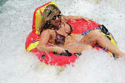 A tuber enjoys the tube chute in Prince Solms Park on the Comal River Sunday July 24, 2011 in New Braunfels. Photo: EDWARD A. ORNELAS, Edward A. Ornelas/Express-News / © SAN ANTONIO EXPRESS-NEWS (NFS)