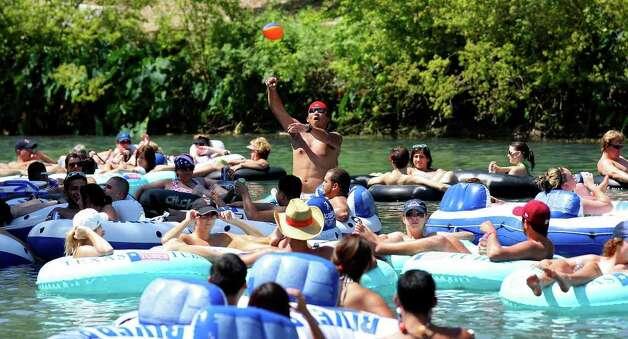 Tubers enjoy the Comal River Sunday July 24, 2011 at Prince Solms Park in New Braunfels. Photo: EDWARD A. ORNELAS, Edward A. Ornelas/Express-News / © SAN ANTONIO EXPRESS-NEWS (NFS)