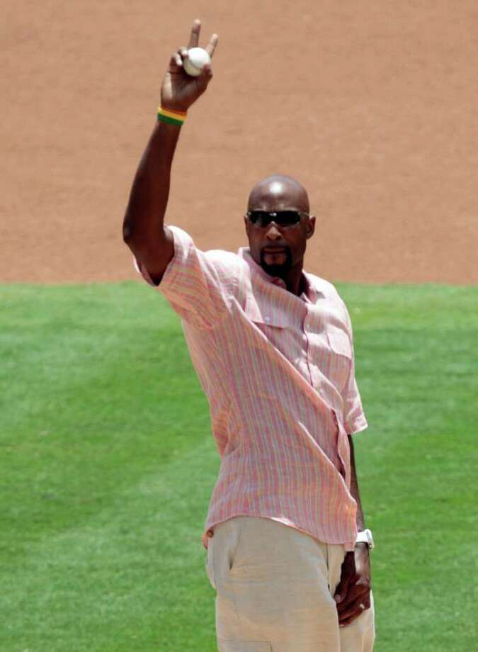 Former Miami Heat basketball player Alonzo Mourning acknowledges the fans before a baseball game between the New York Mets and the Florida Marlins in Miami, Sunday, July 24, 2011. (AP Photo/Alan Diaz) Photo: Alan Diaz