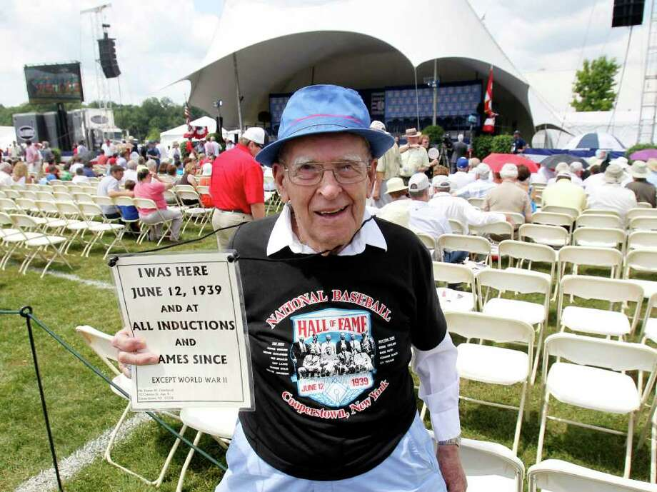 Homer Osterhoudt of Cooperstown, N.Y., poses before the Baseball Hall of Fame ceremony at the Clark Sports Center in Cooperstown, on Sunday, July 24, 2011. Osterhoudt has attended almost all induction ceremonies since 1939. (AP Photo/Mike Groll) Photo: Mike Groll