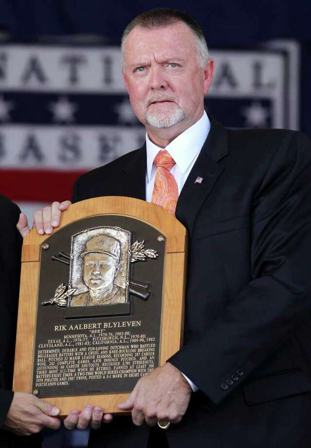 Bert Blyleven holds his plaque after his induction into the Baseball Hall of Fame in Cooperstown, N.Y., on Sunday, July 24, 2011. (AP Photo/Mike Groll) Photo: Mike Groll