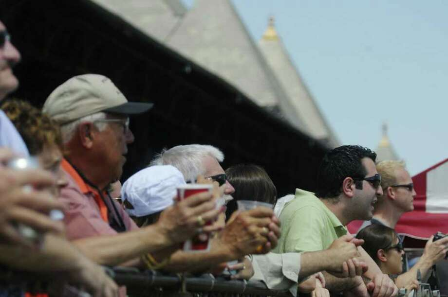 Fans cheer on the horses during the fourth race  at the Saratoga Race Course on Sunday, July 24, 2011 in Saratoga Springs.   (Paul Buckowski / Times Union) Photo: Paul Buckowski  / 00013988A