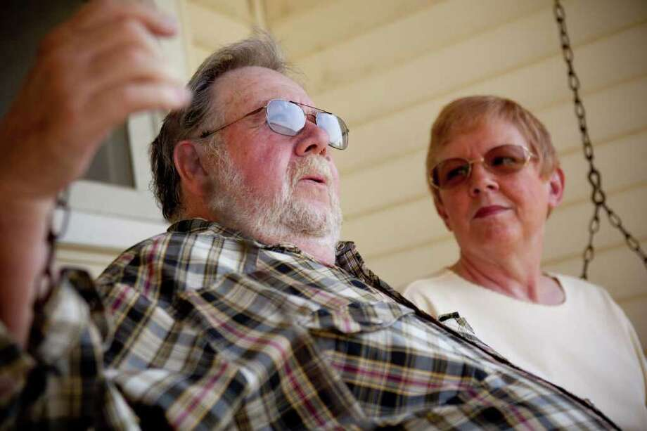 In this June 6, 2011 photo, Ray and Jo Kelly relax on a swing in front of their home in Conklin, Mich., where they live in retirement. The two both take Lipitor and look forward to having extra money when the drug is replaced with a generic in the fall. (AP Photo/Adam Bird) Photo: ADAM BIRD