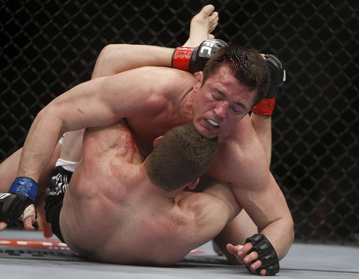 Chael Sonnen, top, grapples with Nate Marquardt during their mixed martial arts middleweight bout Saturday, Feb. 6, 2010 in Las Vegas. Sonnen won by unanimous decision. (AP Photo/Isaac Brekken)